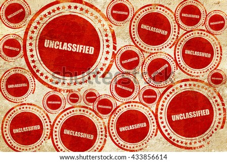 unclassified, red stamp on a grunge paper texture - stock photo