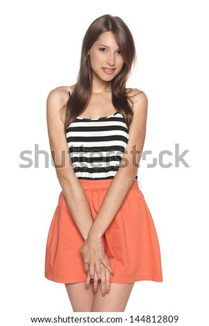 Uncomfortable and awkward looking female isolated against a white background
