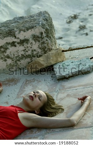 unconscious woman lying on the stairs by sunrise - stock photo