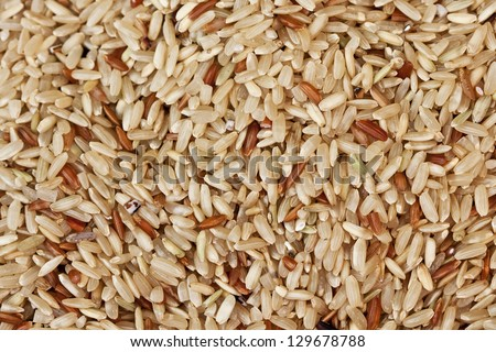 Uncooked brown rice grains background