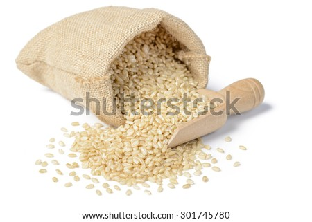 uncooked brown rice on the white background