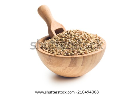 uncooked buckwheat in wooden bowl - stock photo