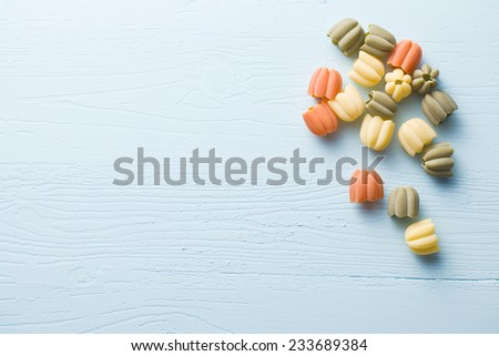 uncooked calici pasta on blue kitchen table - stock photo