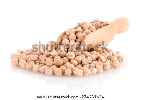 Uncooked chickpeas and wooden scoop on white background. - stock photo