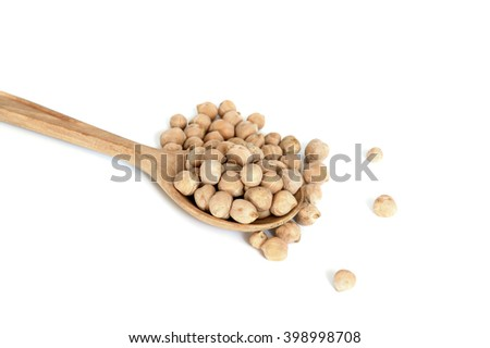 Uncooked chickpeas beans in wooden spoon isolated on white background - stock photo