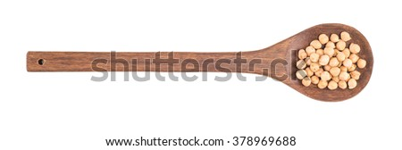 uncooked chickpeas in wooden spoon on white background - stock photo