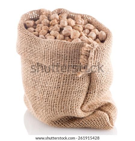 Uncooked chickpeas Uncooked chickpeas on burlap bag on white background. - stock photo