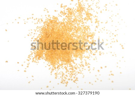 uncooked couscous scattered on white background, isolated - stock photo