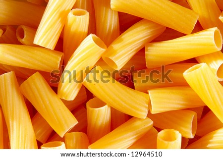 Uncooked italian pasta, may be used as background