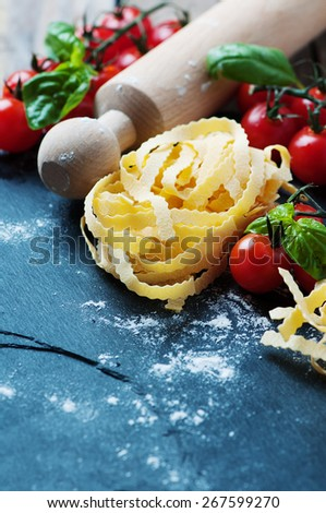 Uncooked italian pasta on the table, selective focus - stock photo