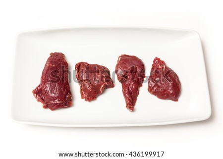 Uncooked kangaroo meat steaks  isolated on a white studio background.