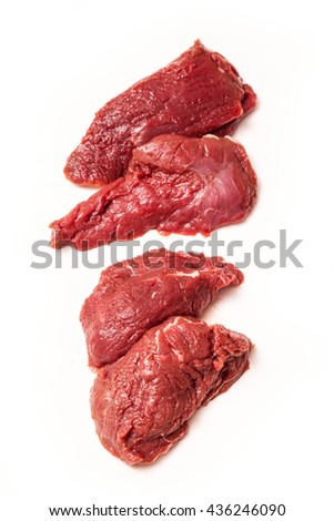 Uncooked kangaroo meat steaks  isolated on a white studio background. - stock photo
