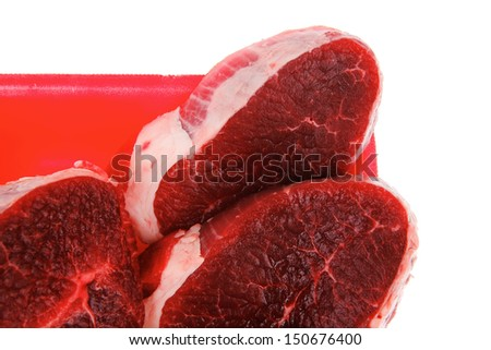 uncooked meat : raw fresh beef pork tenderloin strip ready to cooking on red tray isolated over white background - stock photo