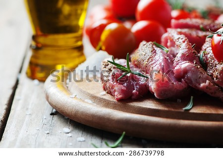 Uncooked meat with herbs and salt, selective focus - stock photo