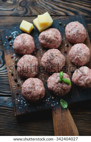 Uncooked meatballs with seasonings, close-up, selective focus