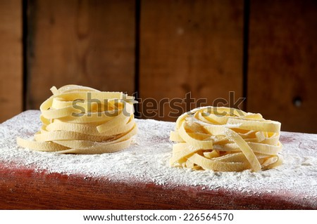 Uncooked pasta freshly prepared with flour and water - stock photo
