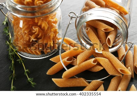 Uncooked pasta in jar, closeup - stock photo
