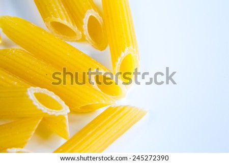 Uncooked pasta penne isolated on white background - stock photo