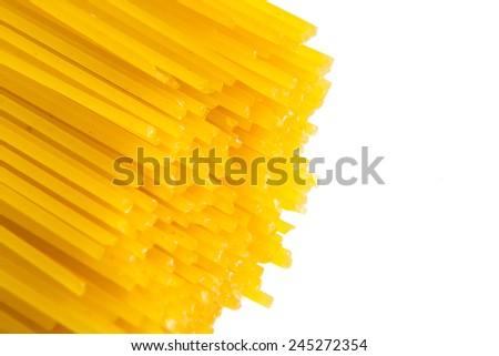 Uncooked pasta spaghetti  isolated on white background - stock photo