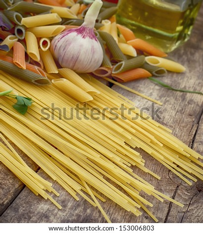 uncooked pasta two species with fresh garlic