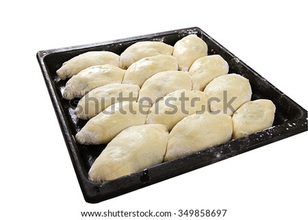 uncooked pies lay on a baking sheet