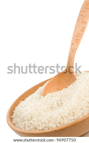 uncooked rice in plate bowl isolated on white background - stock photo
