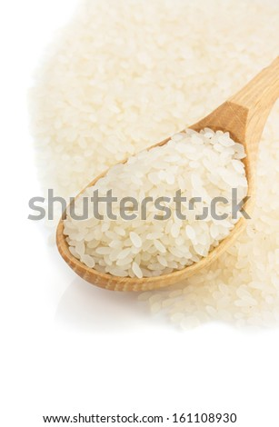 uncooked rice in wooden spoon isolated on white background - stock photo