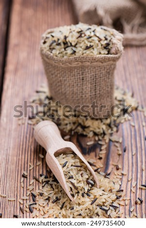 Uncooked Rice (mixed with wild Rice) on rustic background