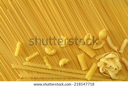 Uncooked spaghetti, and different types and shapes of pasta - stock photo