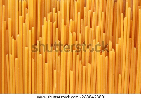 Uncooked spaghetti noodle abstract - stock photo