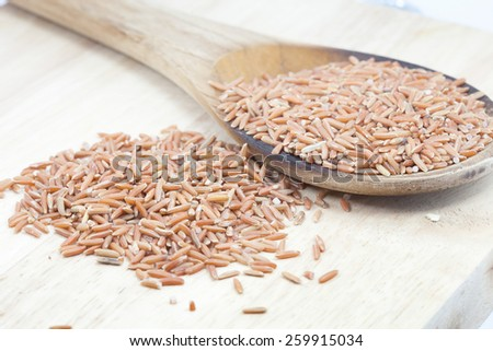 Uncooked Thai brown rice in ladle   rice Healthy Food