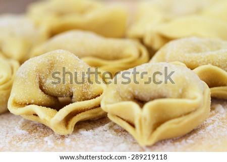 Uncooked tortellini, closeup  - stock photo