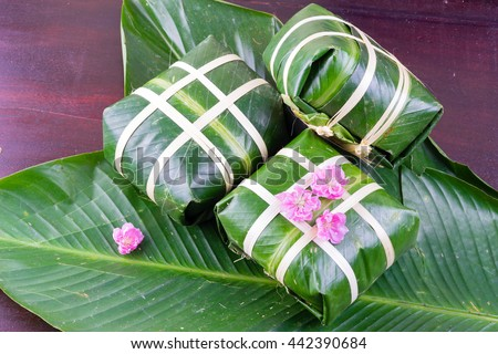 Uncooked Vietnamese Chung Cake isolated. It's a square glutinous sticky rice cake, stuffed with pork meat, green beans and wrapped in bamboo leaf. Traditional Vietnamese New Year (Tet) food.