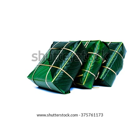 Uncooked Vietnamese Chung Cake isolated on white. It??s a square glutinous sticky rice cake, stuffed with pork meat, green beans and wrapped in bamboo leaf.  Traditional Vietnamese New Year (Tet) food.