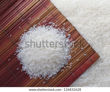 Uncooked white rice - stock photo