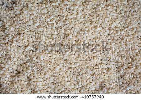 Uncooked white rice, background, selective focus  - stock photo