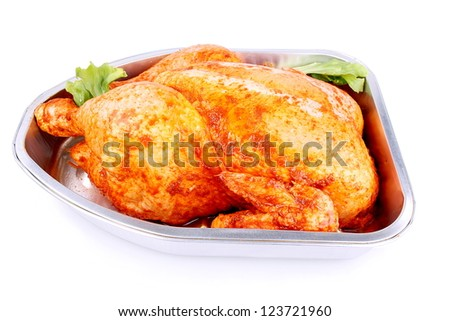 Uncooked whole marinated chicken in aluminum foil tray isolated - stock photo
