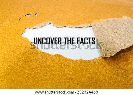 Uncover The Facts appearing behind torn brown envelop  - stock photo