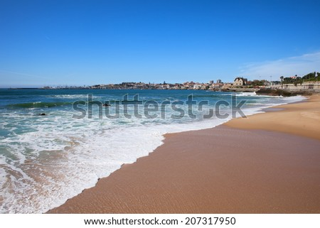 Uncrowded, calm beach in resort town of Estoril in Portugal. - stock photo