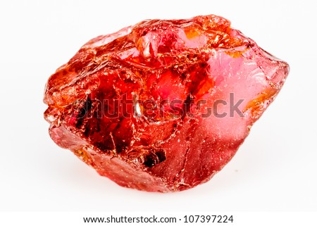 Uncut and raw Garnet crystal.  This natural Garnet has a crisp reddish color. - stock photo