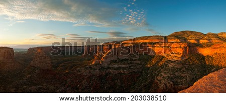 Under a beautiful sunrise, Independence Monument in Colorado National Monument, Colorado. - stock photo