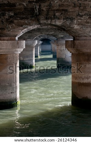under a bridge over the river Seine, in Paris, France - stock photo