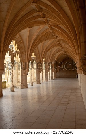 Under an arcade of Hieronymites Monastery, Lisbon, Portugal. UNESCO World Heritage Site. - stock photo