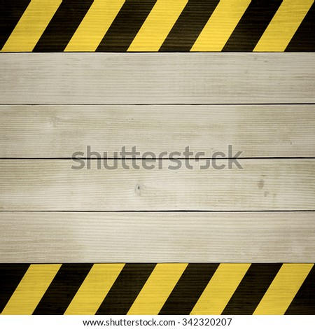 Under Construction / Black and Yellow Hazard Stripes Painted on Wooden Planks