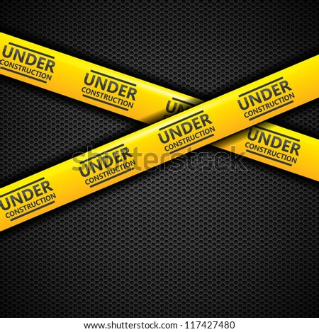 Under construction caution tape - stock photo