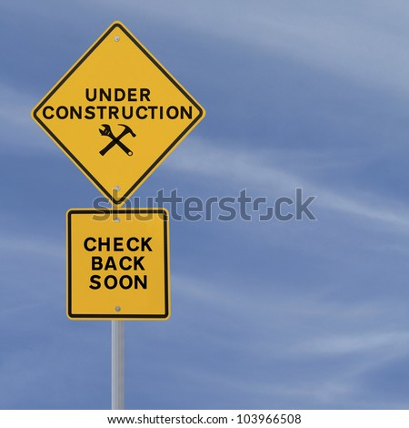 Under construction sign on a blue sky background (with copy space). Applicable for website and web page status updates.