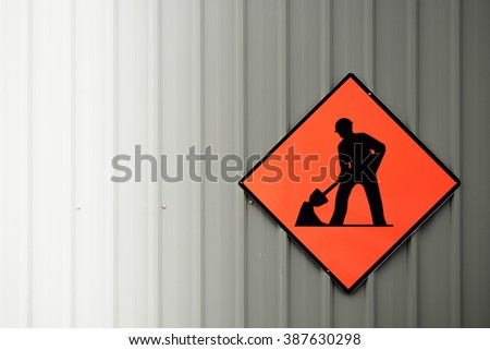 under construction sign on  corrugated steel sheet - stock photo