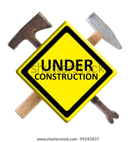 Under construction sign with construction right tools