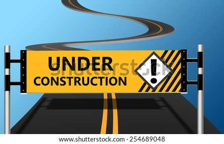Under construction signs in the background of the road - stock photo
