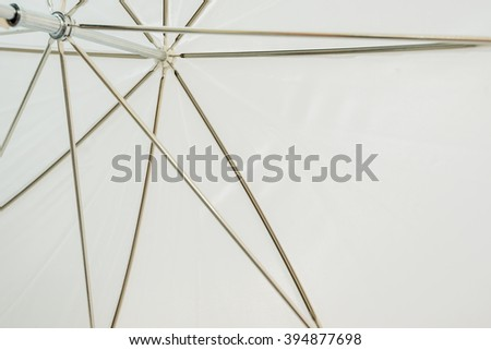Under long-handled umbrella - stock photo